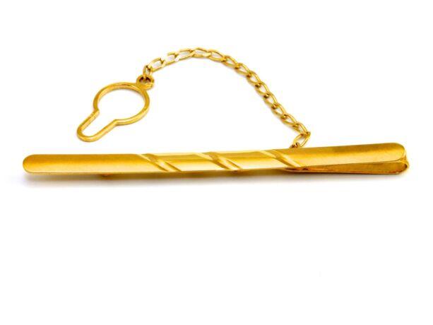 Vésett arany nyakkendőtű