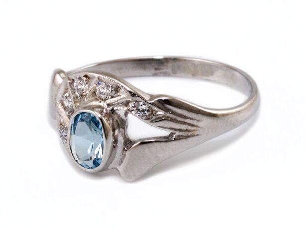 Kék és fehér köves fehérarany eljegyzési gyűrű