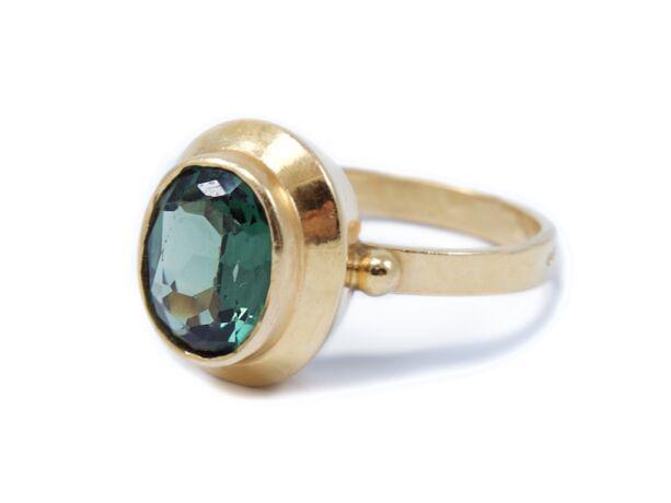 Zöld köves arany női gyűrű